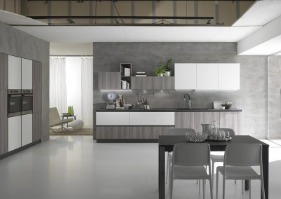 Cucina componibile moderna Gora caratterizzata da rivestimenti di qualità dall'effetto cemento abbinato alle finiture opache e stone
