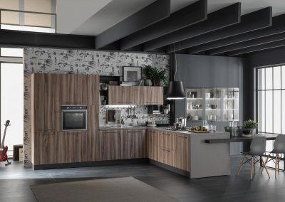 L'isola centrale della cucina moderna Terra può essere completata da un elegante bancone snack a ponte